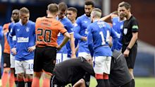 Alfredo Morelos carried off during Rangers' 4-0 win over Dundee United
