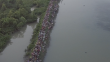Hundreds of Thousands of Rohingyas Ford River into Bangladesh