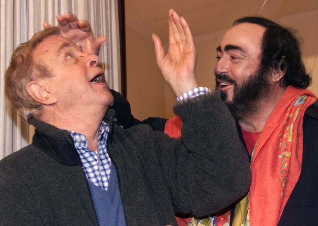 Zeffirelli, seen here with Italian tenor Luciano Pavarotti, worked with some of the greatest stars of opera (AFP Photo/Gabriel BOUYS)