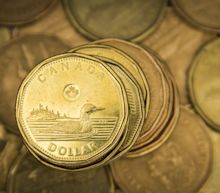Canadian dollar sticks near three-month high as stimulus measures weigh on greenback
