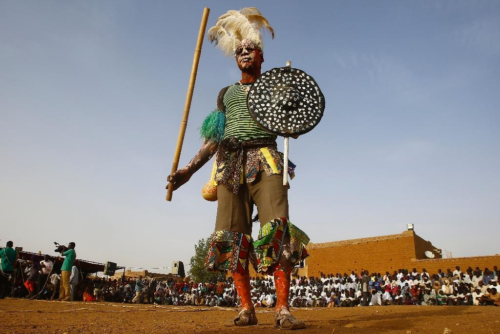A member of Sudan's Nuba community performs a traditional dance during the Nuba Mountains Cultural Heritage Festival, marking the International Day of the World's Indigenous Peoples in the capital's twin city of Omdurman, Sudan on August 15, 2015 (AFP Photo/Ashraf Shazly)