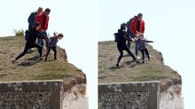 Shocking moment girl pulled from edge of cliff notorious for deadly falls