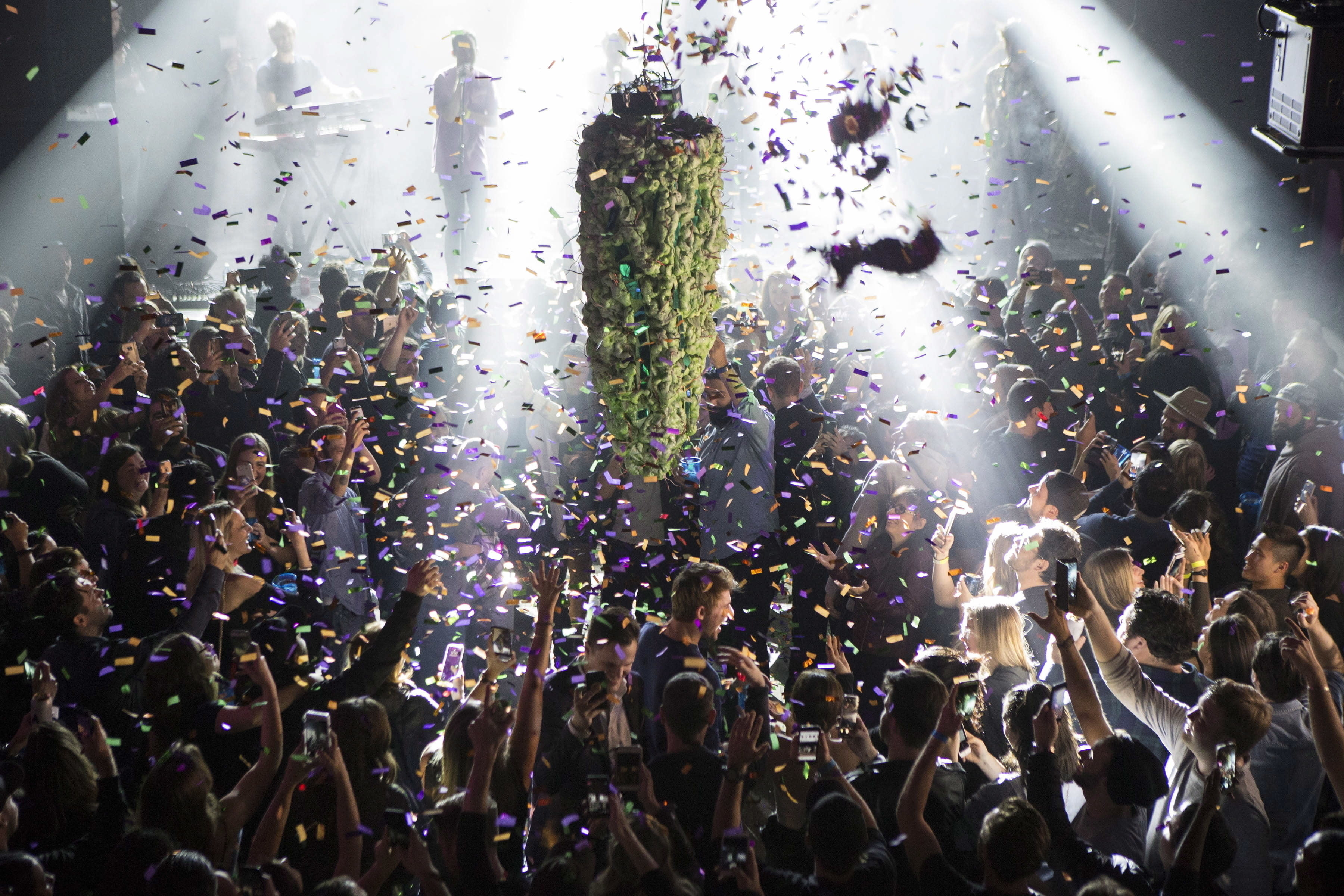 FILE - In this Oct. 17, 2018, file photo, a depiction of a cannabis bud drops from the ceiling at Leafly's countdown party in Toronto, as midnight passes and marks the first day of the legalization of cannabis across Canada. China has become the latest Asian country to warn its citizens in Canada about marijuana after it was legalized for recreational use there. (Chris Young/The Canadian Press via AP, File)