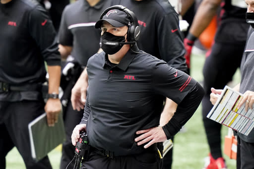 Atlanta Falcons head coach Dan Quinn watches play against the Chicago Bears during the second half of an NFL football game, Sunday, Sept. 27, 2020, in Atlanta. (AP Photo/Brynn Anderson)