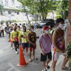 Philippines virus cases soar past 50,000 as lockdown eases