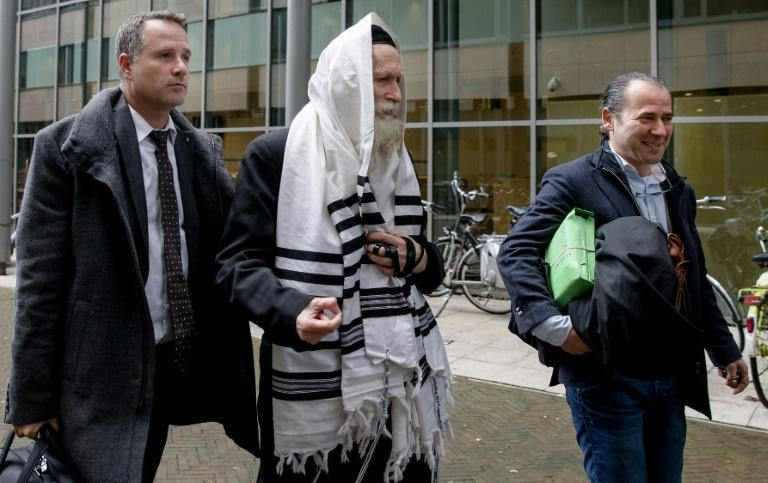 An Israeli rabbi, Eliezer Berland (C), seen arriving at a Netherlands court in November 2014