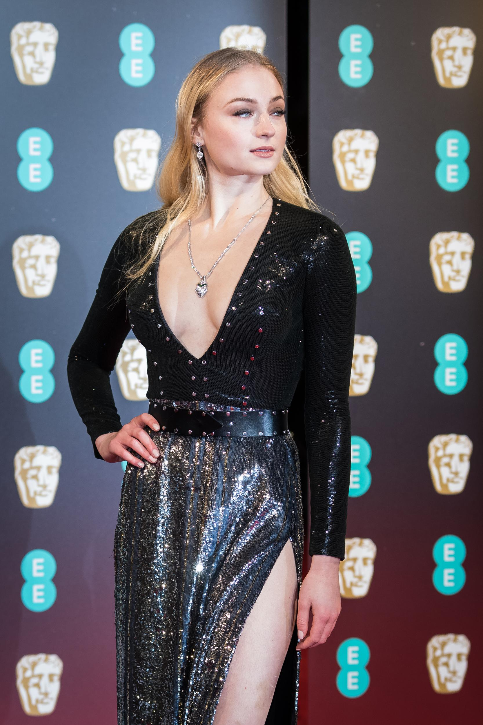 Sophie Turner poses for photographers upon arrival at the BAFTA Film Awards, in London, Sunday, Feb. 12, 2017. (Photo by Vianney Le Caer/Invision/AP)