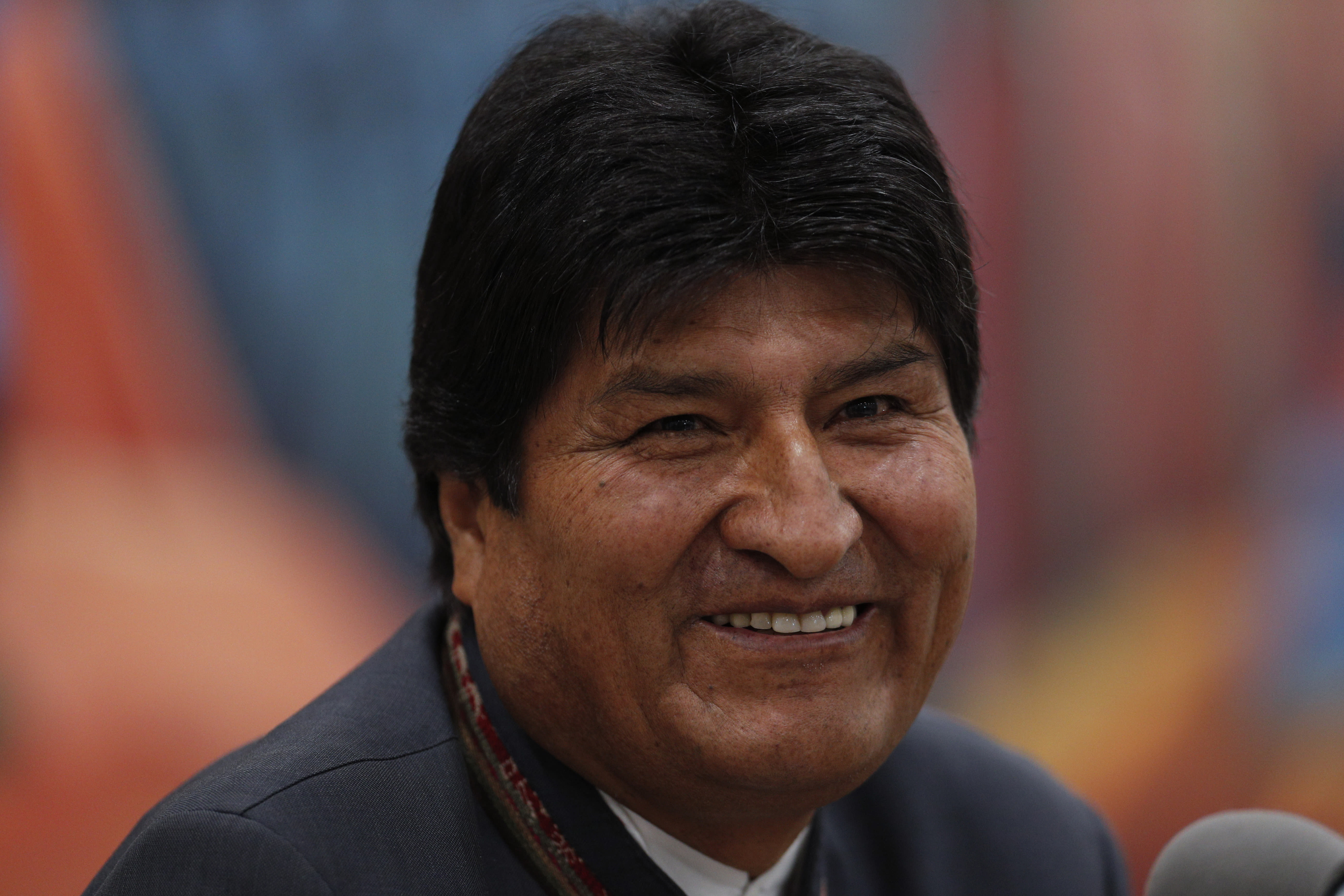 FILE - In this Oct. 24, 2019 file photo, Bolivia's President Evo Morales smiles during a press conference in La Paz, Bolivia. President Morales challenged his critics on Saturday, OCt. 27, to prove alleged fraud in his re-election, saying he'd welcome an international audit of the vote count. Electoral authorities say the soclalist leader narrowly won enough votes Sunday to avoid a December runoff election that might have seen opponents unite against him. (AP Photo/Juan Karita, File)