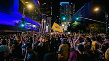 Lakers fans celebrate in downtown Los Angeles despite COVID-19 warnings after NBA Finals win