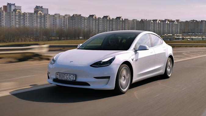 Minsk, Belarus - March 20, 2020: Tesla Model 3 Performance drives on a highway. It has dual motor all-wheel drive, total output is 451 hp. Model 3 is the world's best-selling plug-in electric vehicle.