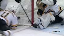 Tuukka Rask reacts in time for the save