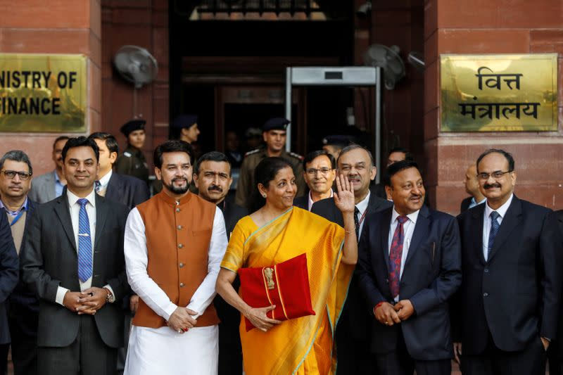 India's Finance Minister Nirmala Sitharaman holds budget papers as she leaves her office to present the federal budget in the parliament in New Delhi