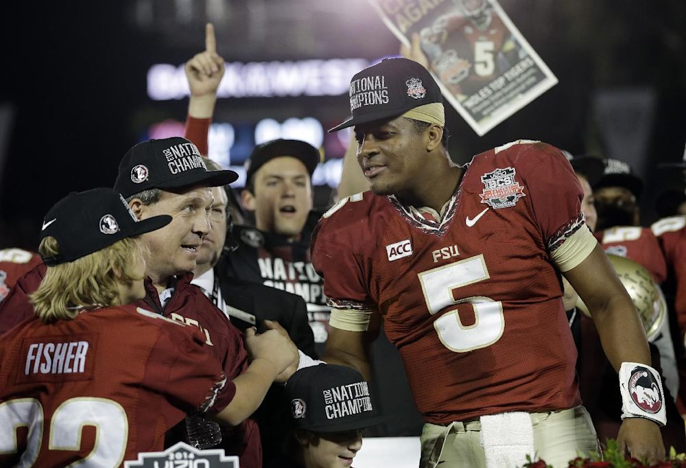 Florida State head coach Jimbo Fisher and Jameis Winston (5) celebrate after the NCAA BCS National Championship college football game against Auburn Monday, Jan. 6, 2014, in Pasadena, Calif. Florida State won 34-31