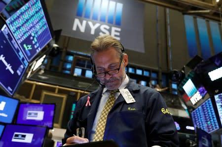 Stocks rise with eyes on trade talks; pound rallies