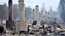 Firefighters battle California blazes, search for victims