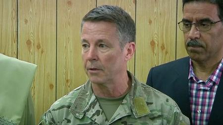 Commander of NATO forces in Afghanistan U.S. General Scott Miller attends a meeting in the Kandahar Governor's Compaund in Kandahar