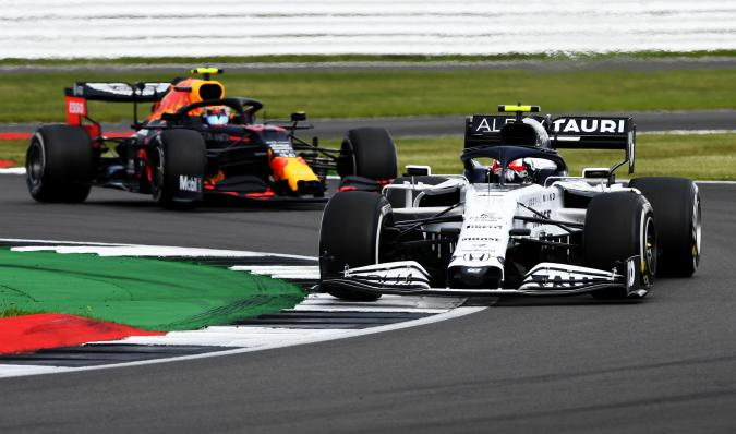 NORTHAMPTON, ENGLAND - AUGUST 02: Pierre Gasly of France driving the (10) Scuderia AlphaTauri AT01 Honda leads Alexander Albon of Thailand driving the (23) Aston Martin Red Bull Racing RB16 on track during the F1 Grand Prix of Great Britain at Silverstone on August 02, 2020 in Northampton, England. (Photo by Rudy Carezzevoli/Getty Images)