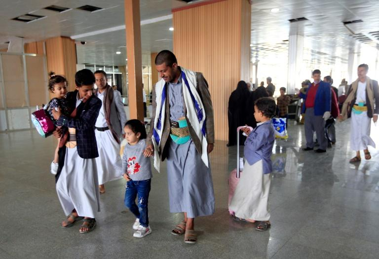 Yemeni children who were airlifted to Jordan to undergo treatment for critical illnesses arrive in October 2020 in the capital Sanaa, where supporters of Huthi rebels have also been freed in an apparent swap for captive Americans