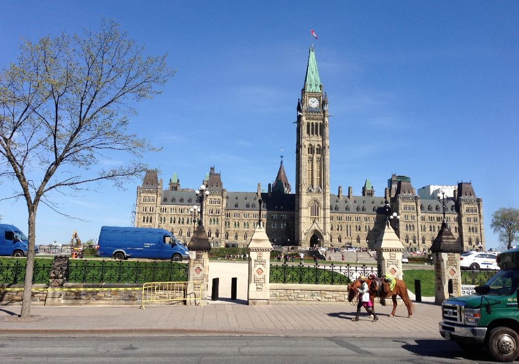 Welsh equestrian Megan Lewis walks her horse past Canada's parliament on May 7, 2015 in Ottawa, Ontario