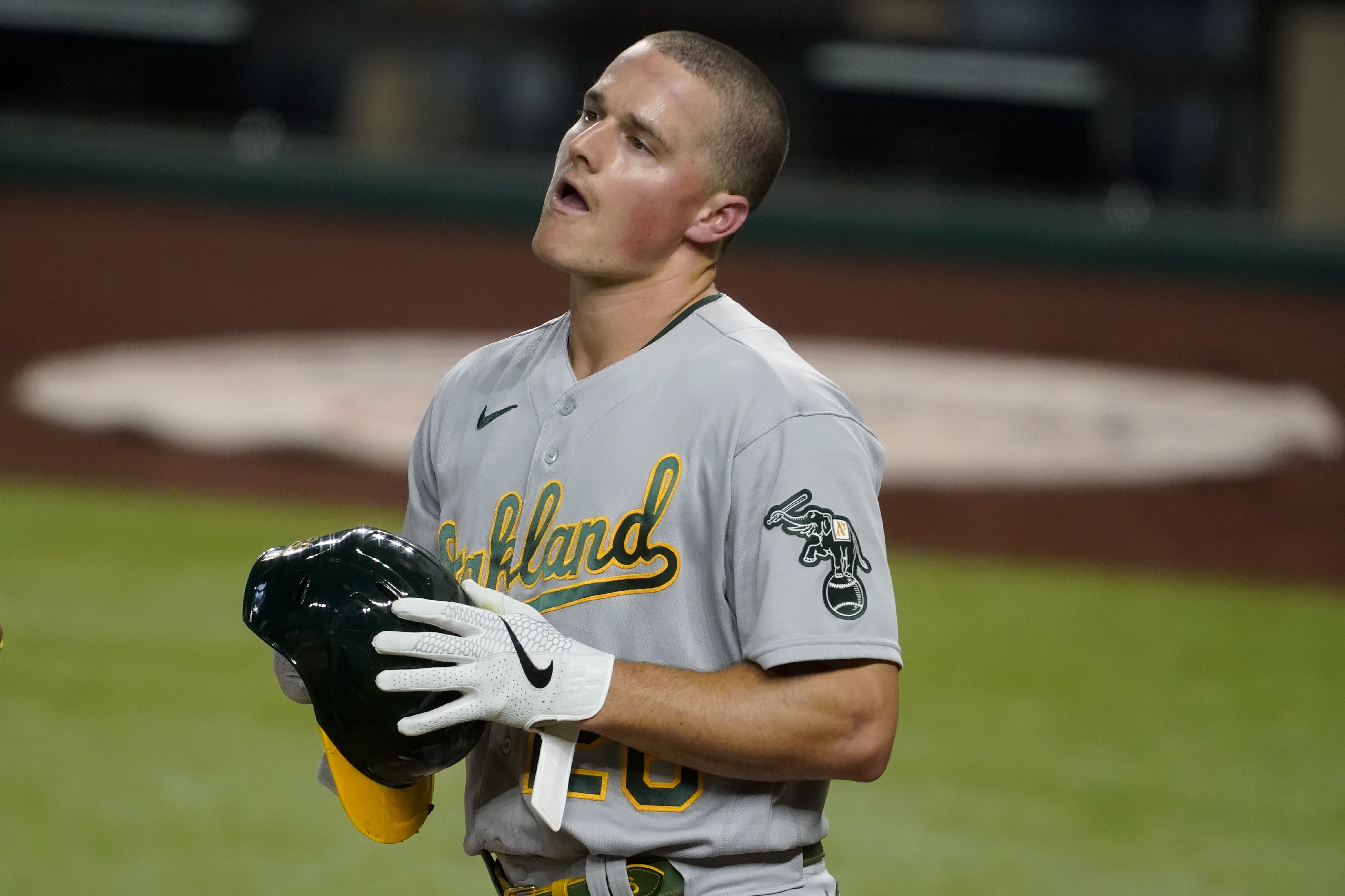 Oakland Athletics' Matt Chapman walks behind the plate after being hit in the head by a pitch from Texas Rangers' Kyle Gibson in the fourth inning of a baseball game in Arlington, Texas, Tuesday, Aug. 25, 2020. Chapman continued playing in the game. (AP Photo/Tony Gutierrez)