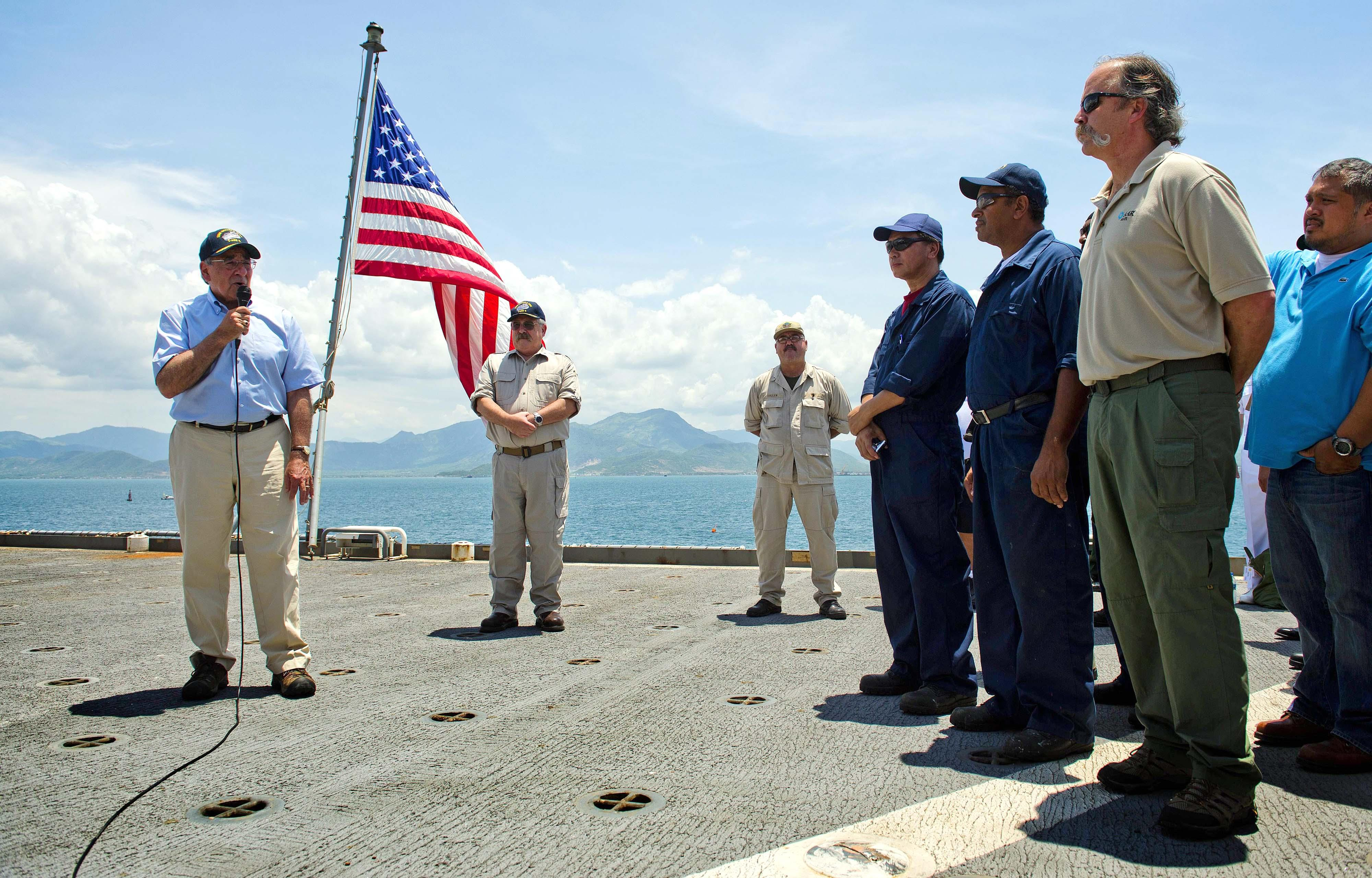 U.S. Secretary of Defense Leon Panetta, left, speaks to members of the crew as he visits USNS Richard E. Byrd in Cam Ranh Bay, Vietnam, June 3, 2012. Panetta toured the former U.S. air and naval base in the bay, becoming the most senior American official to go there since the war ended. (AP Photo/Jim Watson, Pool)
