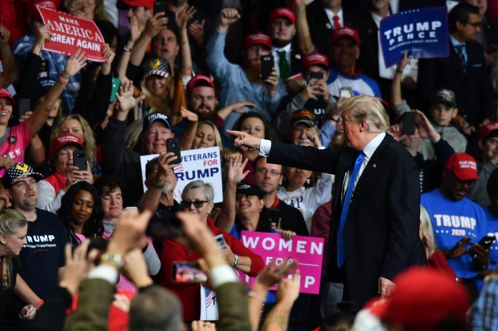 "US President Donald Trump gestures during a ""Make America Great Again"" rally at Bojangles' Coliseum in Charlotte, North Carolina. (AFP Photo/Nicholas Kamm)"