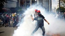 Venezuelan soldier shoots protester dead in airbase attack, minister says