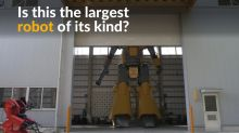 Japanese designer realizes his dream by creating 28-ft robot