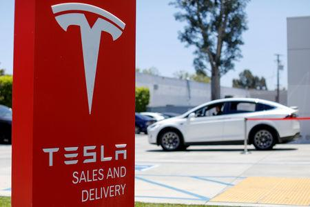 File Photo A Tesla S And Service Center Is Shown In Costa Mesa California
