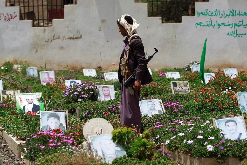 A Yemeni Huthi supporter visits a cemetary in Sanaa, on March 25, 2016