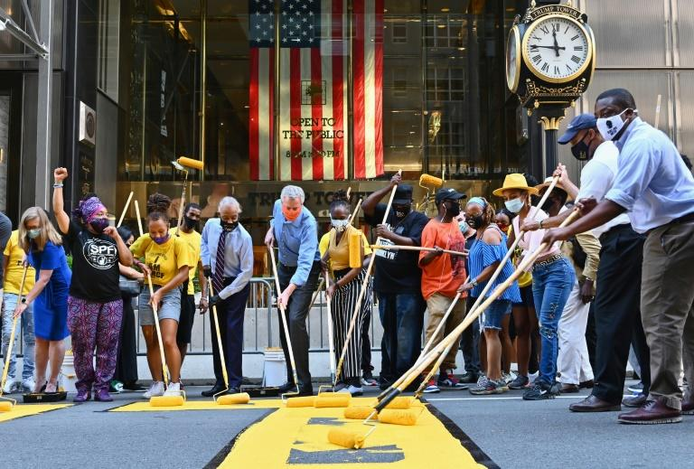 (Center L-R) The Reverend Al Sharpton, New York Mayor Bill de Blasio and his wife Chirlane McCray, paint a Black Lives Matter mural outside of Trump Tower on Fifth Avenue on July 9, 2020 in New York City (AFP Photo/Angela Weiss)