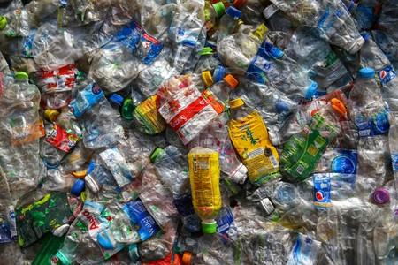 FILE PHOTO: Pressed plastic waste ready for loading is seen at the Prabkaya Recycle Factory in Pathum Thani