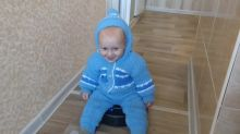 Adorable toddler rides a robot vacuum cleaner