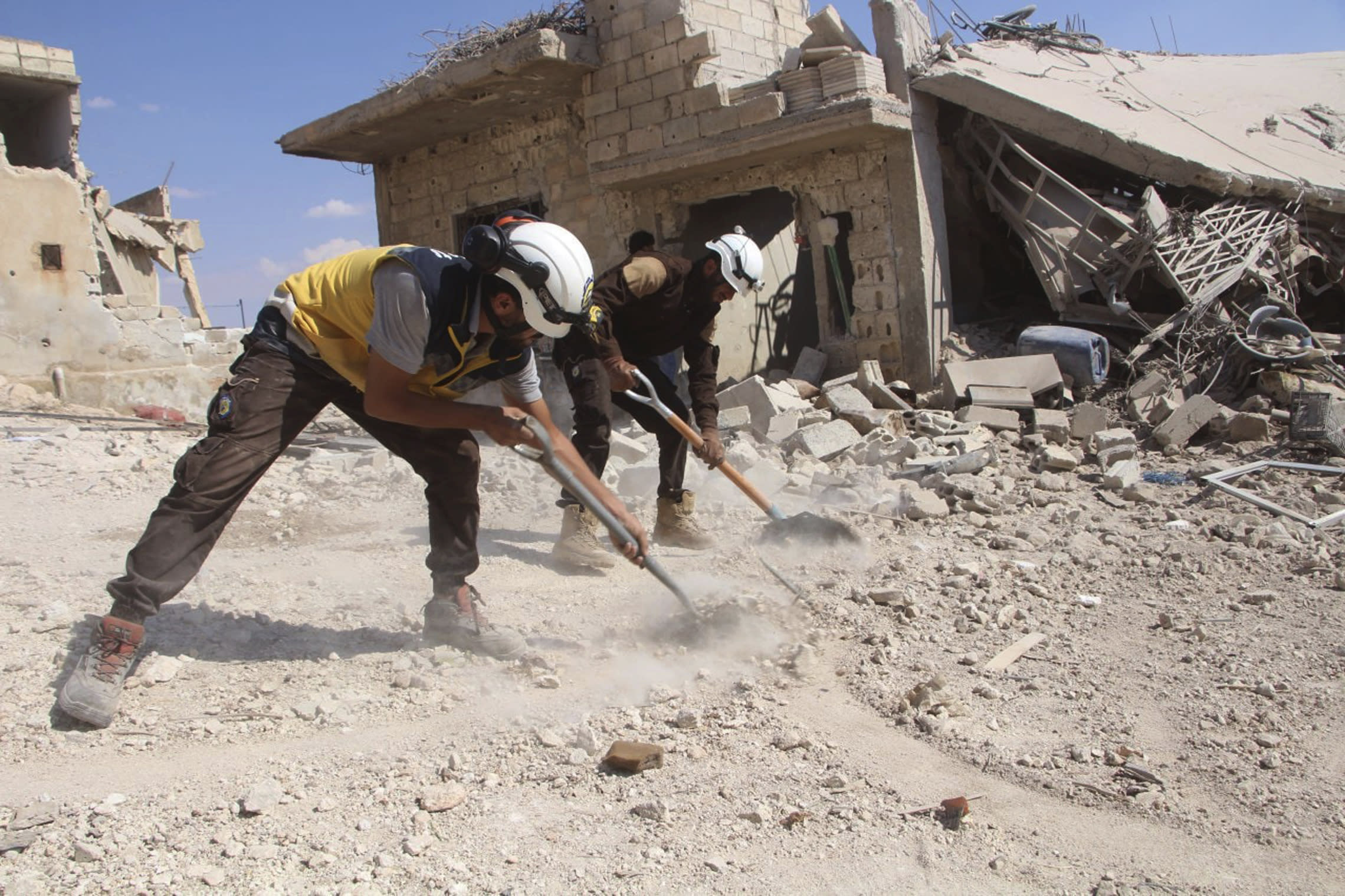 This photo released on Monday, Sept. 10, 2018 by the Syrian Civil Defense group known as the White Helmets, shows civil defense workers clean rubble from a house which was damaged by a Syrian government airstrike, in Hobeit village, near Idlib, Syria. High-level diplomats from Iran, Russia and Turkey were meeting Tuesday with the U.N. envoy for Syria about creating a committee to revise the war-battered country's constitution. Tuesday's talks in Geneva under U.N. envoy Staffan de Mistura come amid concerns he and other U.N. officials have expressed about a looming battle for Idlib. (Syrian Civil Defense White Helmets via AP) (Syrian Civil Defense White Helmets via AP)