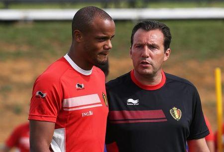 Belgium's coach Wilmots talks with Kompany during a training session in Mogi das Cruzes