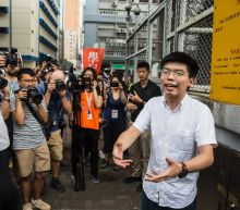 Hong Kong activist Joshua Wong leaves jail, vows to join protests