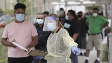 The Latest: India sets another daily record for virus cases