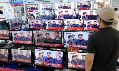 A man watches TV news report about North Korea's nuclear test at an electronic shop in Seoul