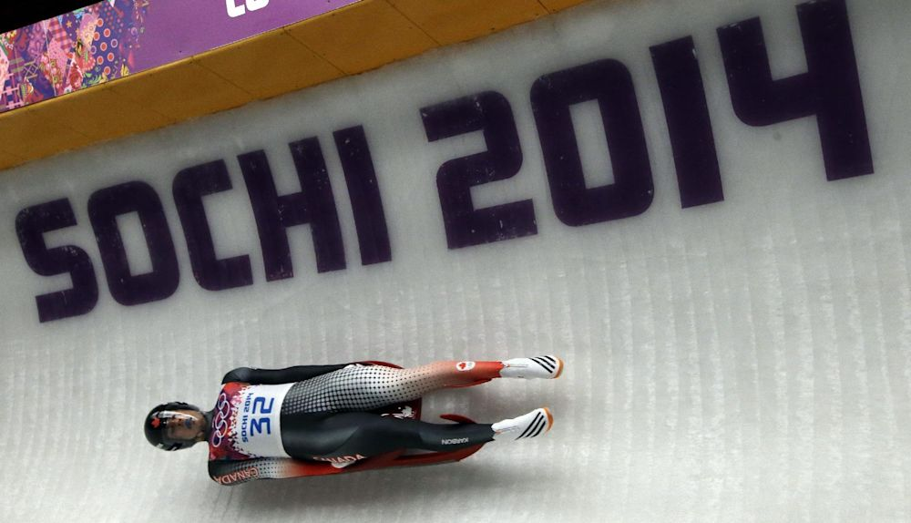 John Fennell of Canada takes turn five in the third run during the men's singles luge final at the 2014 Winter Olympics, Sunday, Feb. 9, 2014, in Krasnaya Polyana, Russia