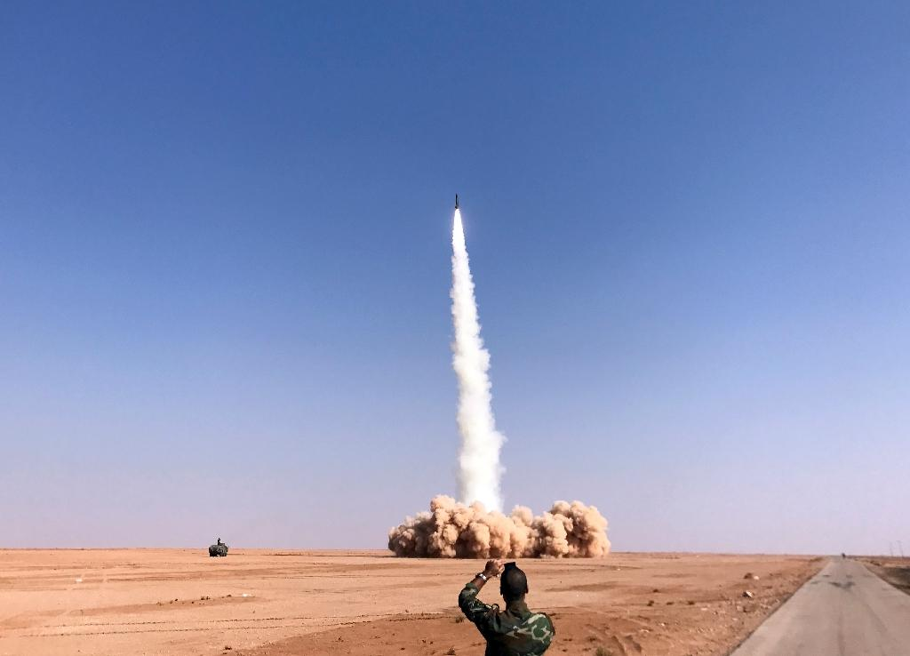 A rocket is fired by Syrian forces near the border town of Albu Kamal on November 10, 2017