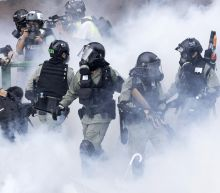 PHOTOS: Hong Kong police storm university held by protesters