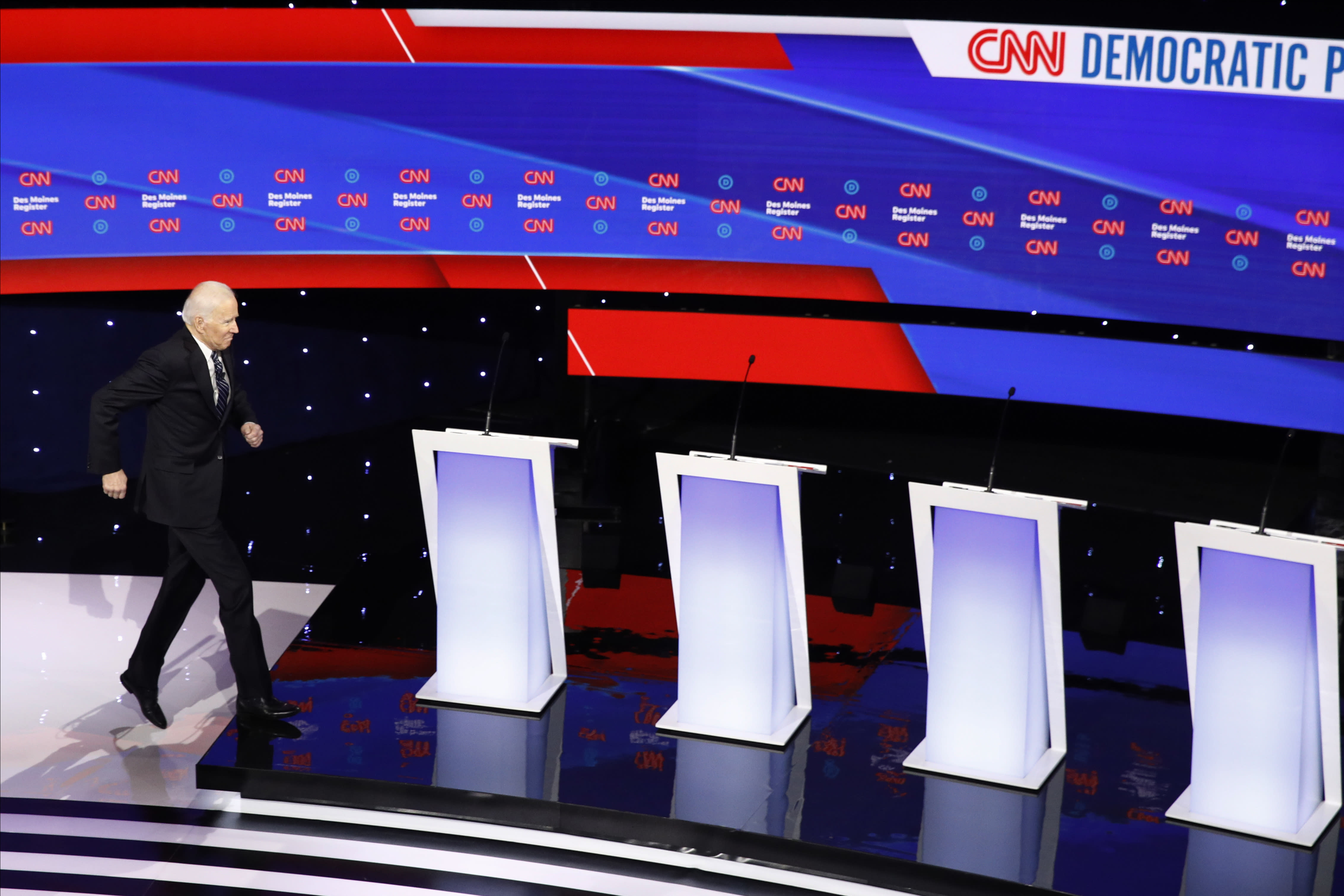 FILE - In this Jan. 14, 2020, file photo Democratic presidential candidates former Vice President Joe Biden, takes the stage before a Democratic presidential primary debate hosted by CNN and the Des Moines Register in Des Moines, Iowa. Biden has won the last few delegates he needed to clinch the Democratic nomination for president. (AP Photo/Patrick Semansky, File)