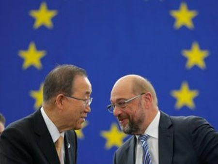 U.N. Secretary General Ban Ki-moon (L) shakes hands with European Parliament President Martin Schulz after the European Parliament vote in favor of the Paris U.N. COP 21 Climate Change agreement during a voting session at the European Parliament in Strasbourg, France, October 4, 2016. REUTERS/Vincent Kessler