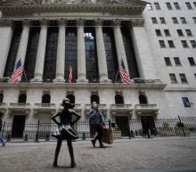 Wall Street ends down as data spooks investors awaiting Fed report