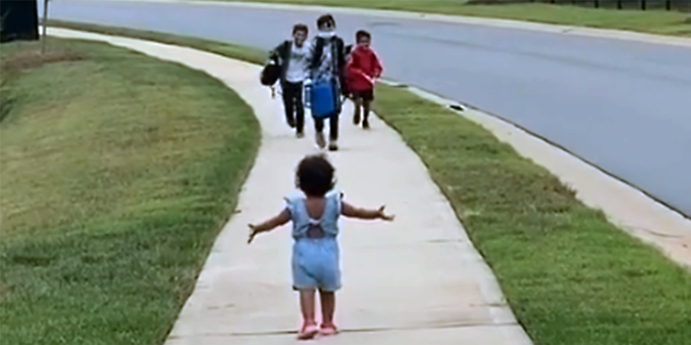 Watch the sweet way this little girl reunites with her big brothers after school