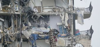 1 dead, 99 unaccounted for after condo collapses