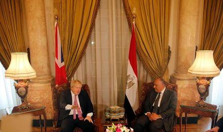 Egyptian foreign minister Sameh Shoukry meets with British Foreign Secretary Boris Johnson at Tahrir Palace in Cairo