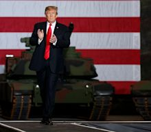 Trump visits tank factory and renews attack on war hero McCain