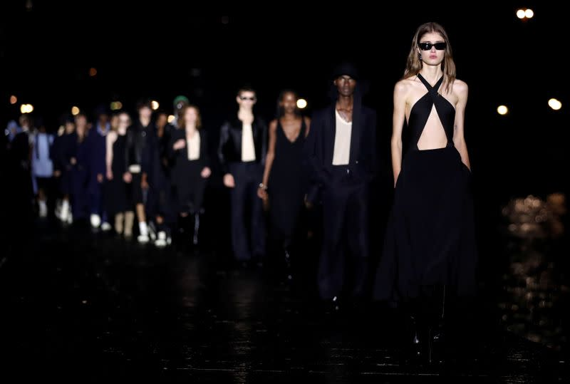 Parisian label AMI parades models by the Seine for fashion week