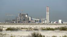 Planta de carbón en la tierra del petróleo